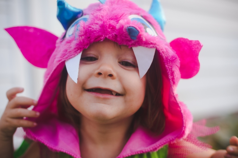 Someone has decided she is going to be a dragon for Halloween and she wanted to wear the costume as soon as she got it.